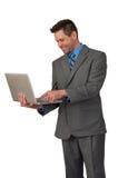 Uomo di affari con il computer portatile Fotografie Stock