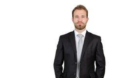 Ritratto di giovane uomo d'affari che sta nello studio Fotografie Stock