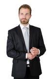 Ritratto di giovane uomo d'affari che sta nello studio Immagine Stock
