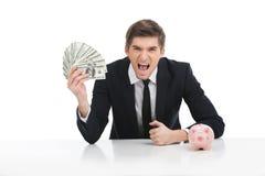 Ritratto di giovane uomo d'affari che tiene i dollari Immagini Stock