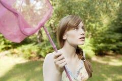 Ritratto di picnic con la rete della farfalla Fotografia Stock