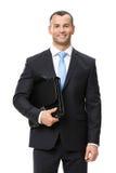 Ritratto di ritratto a mezzo busto dell'uomo d'affari che tiene caso fotografia stock