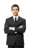 Ritratto di ritratto a mezzo busto dell'uomo d'affari con le mani attraversate Immagine Stock Libera da Diritti