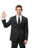 Ritratto di ritratto a mezzo busto dell'uomo d'affari d'ondeggiamento della mano immagini stock libere da diritti