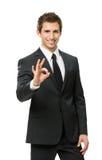 Ritratto di ritratto a mezzo busto dell'uomo d'affari gesturing giusto Immagine Stock Libera da Diritti