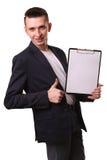 Ritratto di scrittura dell'uomo d'affari sulla lavagna per appunti isolata sulla b bianca Fotografia Stock Libera da Diritti