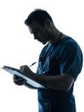Ritratto di scrittura della siluetta dell'uomo di medico Immagini Stock Libere da Diritti