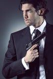Ritratto di un agente segreto attraente fotografia stock libera da diritti
