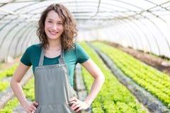 Ritratto di un agricoltore attraente in una serra Fotografia Stock