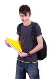 Ritratto di un allievo maschio con i libri Immagini Stock Libere da Diritti