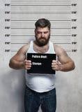 Ritratto di un criminale indurito immagine stock libera da diritti