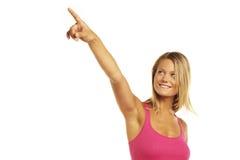 Ritratto di un indicare felice della giovane donna Immagini Stock Libere da Diritti