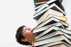 Ritratto di un ragazzo con i libri Immagini Stock Libere da Diritti