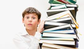Ritratto di un ragazzo con i libri Fotografie Stock Libere da Diritti