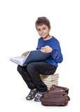 Ritratto di un ragazzo con i libri di scuola Immagini Stock
