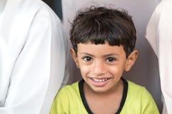 Ritratto di un ragazzo dell'Oman in un vestito dell'Oman tradizionale Nizwa, Oman - 15/OCT/2016 Immagini Stock Libere da Diritti