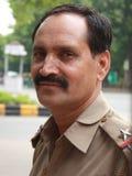 Ritratto di un ufficiale di polizia, Nuova Delhi del primo piano Immagini Stock Libere da Diritti