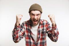 Ritratto di un uomo barbuto arrabbiato immagini stock libere da diritti