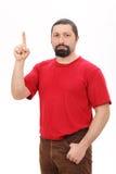 Ritratto di un uomo che indica in su Fotografia Stock Libera da Diritti