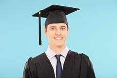 Ritratto di un uomo con il cappello di graduazione Immagini Stock