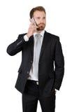 Ritratto di un uomo d'affari bello che parla sul telefono Immagini Stock Libere da Diritti