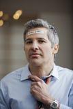 Ritratto di un uomo d'affari con il codice a barre sulla fronte Immagini Stock Libere da Diritti