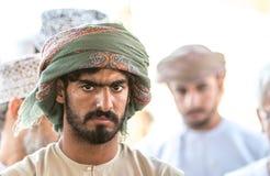 Ritratto di un uomo dell'Oman in un vestito dell'Oman tradizionale Nizwa, Oman - 15/OCT/2016 Immagini Stock Libere da Diritti