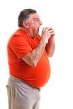 Ritratto di un uomo di peso eccessivo affamato fotografia stock
