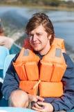 Ritratto di un uomo in giubbotto di salvataggio Immagine Stock