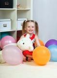 Ritratto di una bambina che gioca con le palle Fotografia Stock Libera da Diritti