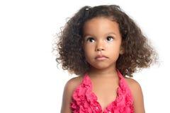 Ritratto di una bambina con un'acconciatura di afro fotografia stock libera da diritti