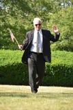 Ritratto di una camminata di Politico With American Flag del maschio fotografia stock