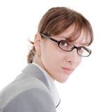 Ritratto di una donna di affari in vetri fotografia stock libera da diritti