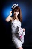 Ritratto di una donna in studio con il giornale Immagine Stock Libera da Diritti