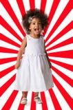 Ritratto di una ragazza allegra prescolare integrale Bambino su fondo geometrico fotografia stock