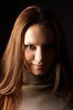 ritratto di una ragazza dentro fas su un backgr nero Immagini Stock