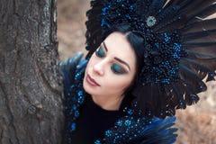 Ritratto di una ragazza in un costume della fase corvo Fotografie Stock Libere da Diritti
