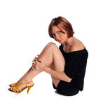 Ritratto di una seduta della giovane donna Fotografie Stock