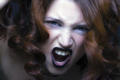 Ritratto diabolico della ragazza del vampiro Fotografia Stock