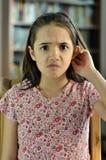 La bambina sembra confusa Immagine Stock Libera da Diritti
