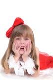 Ritratto emozionale di una ragazza allegra in vestito rosso su fondo bianco Nuovo anno Immagini Stock Libere da Diritti