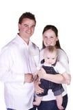 Ritratto felice della famiglia con la madre, il padre ed il figlio fotografia stock