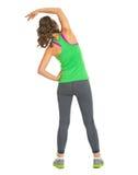 Ritratto integrale di allungamento della donna di forma fisica. retrovisione Fotografia Stock Libera da Diritti