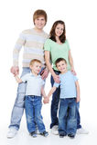 Ritratto integrale di giovane famiglia felice Fotografia Stock
