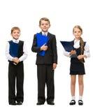 Ritratto integrale di piccoli bambini con le cartelle Immagini Stock Libere da Diritti