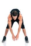 Ritratto integrale di un allungamento dell'uomo di forma fisica Fotografia Stock