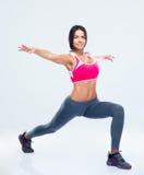 Ritratto integrale di un allungamento della donna di forma fisica Immagine Stock