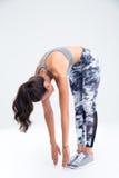 Ritratto integrale di un allungamento della donna di forma fisica Immagini Stock Libere da Diritti