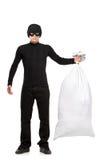 Ritratto integrale di un ladro che tiene un sacchetto Fotografie Stock Libere da Diritti