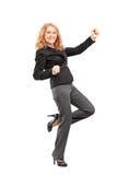 Ritratto integrale di una donna che gesturing felicità Immagine Stock
